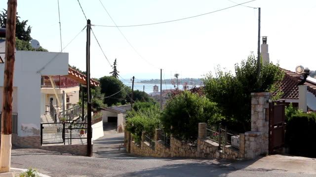 Asphalt is going trough decorated settlement, downhill street video