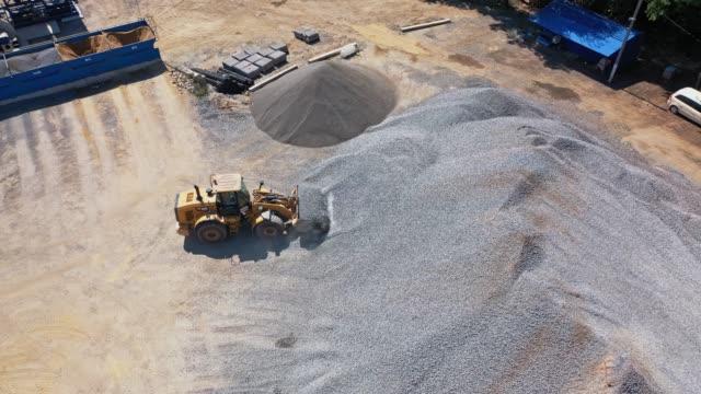 Bидео Asphalt plant with running bulldozer.