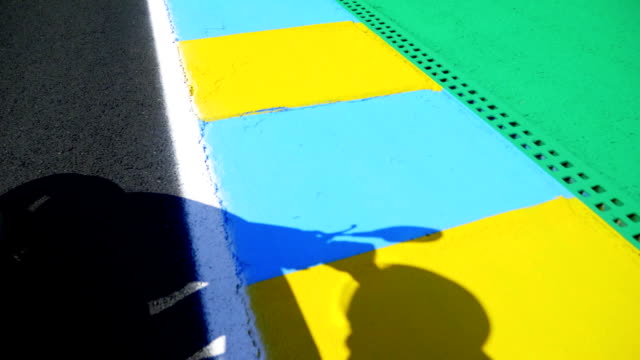 Asphalt Road With White and Colorful Stripes video