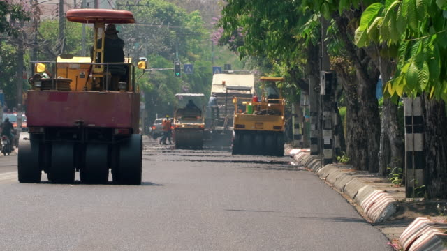 Asphalt roller working on very hot days. Road construction. Transport industry. Growing cities