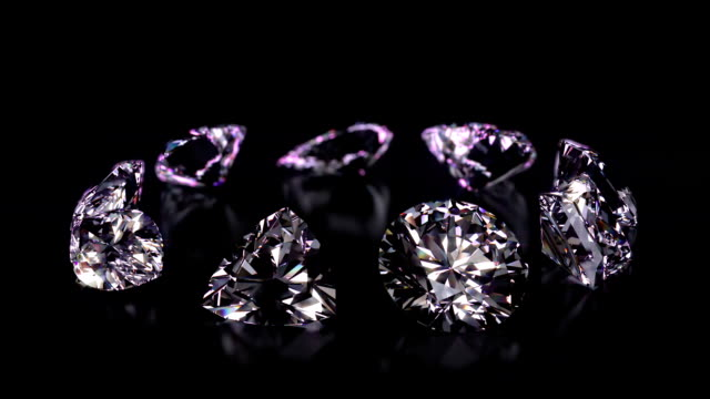 Assorted different shaped diamonds revolving video