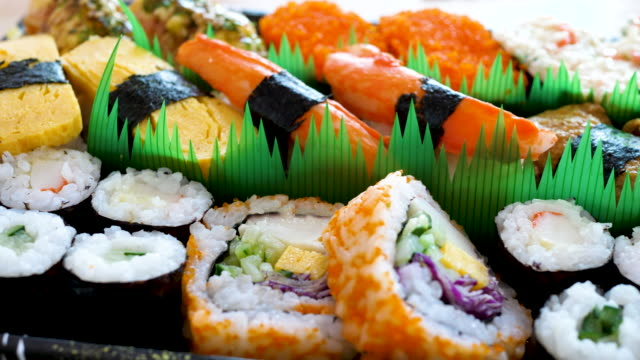assorted row of sushi - rotolo video stock e b–roll