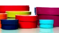 istock Assortment of colorful round boxes isolated against white 1253206151