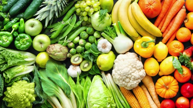 Assortment of fresh organic fruits and vegetables in rainbow colors Panoramic food background with assortment of fresh organic fruits and vegetables in rainbow colors table top view stock videos & royalty-free footage