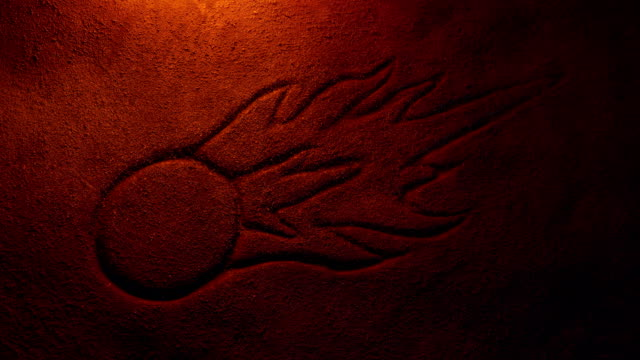 Asteroid Ancient Stone Carving Lit Up With Fire