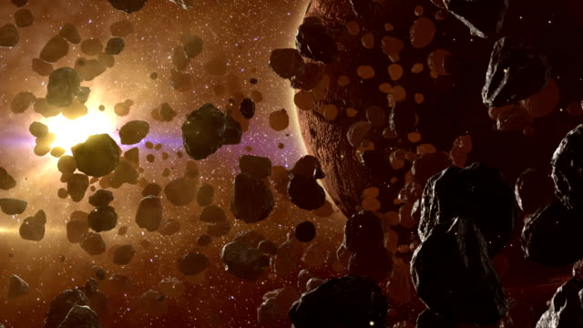 Asteroid field hovering near dead planet in outer space video