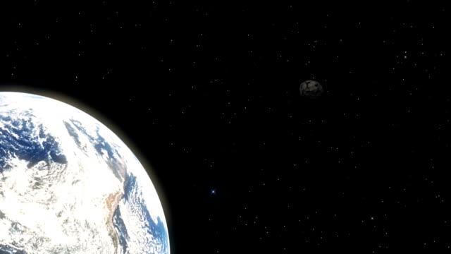 asteroid svävar mot jorden - earth from space bildbanksvideor och videomaterial från bakom kulisserna