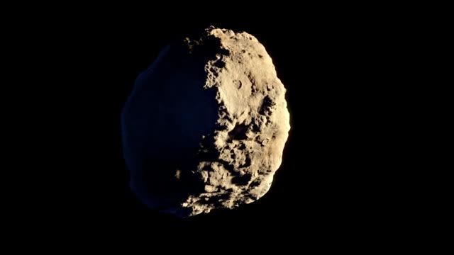 vídeos y material grabado en eventos de stock de asteroide que gira en órbita aislada - roca