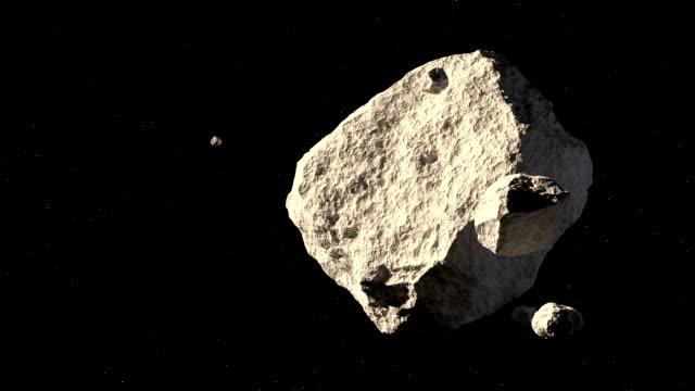астероиды в космосе - space background стоковые видео и кадры b-roll
