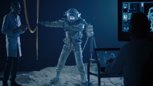 Astronaut and scientists testing spacesuit mobility video