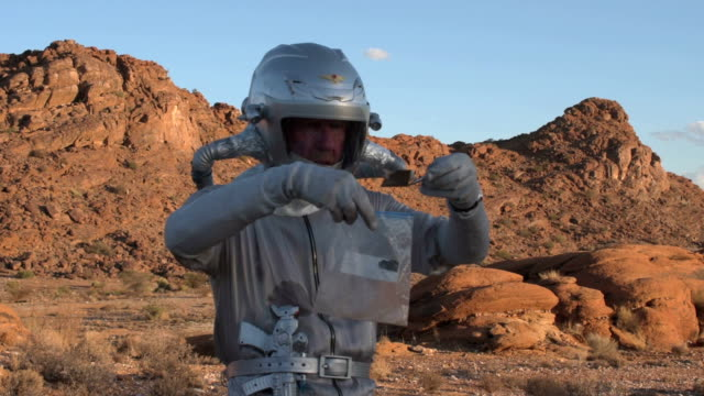 Astronaut collecting soil samples video