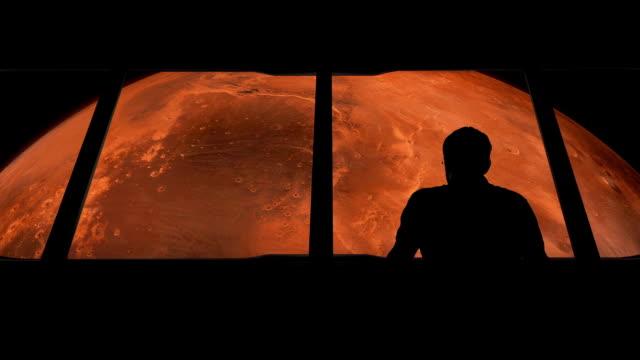 astronaut ser på mars från shuttle - mars bildbanksvideor och videomaterial från bakom kulisserna
