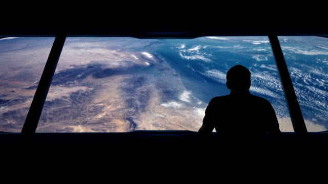 Astronaut Looks Out At Earth From Orbit video
