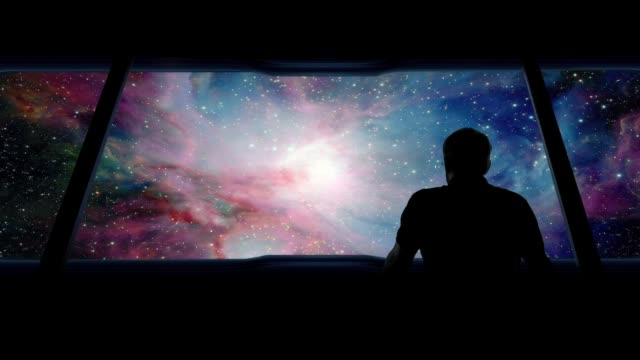 astronaut looks out traveling into vast galaxy - god stock videos & royalty-free footage