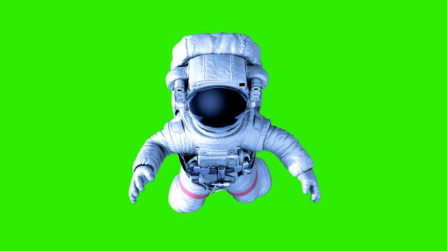 astronaut auf grünem hintergrund - raumanzug stock-videos und b-roll-filmmaterial