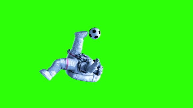 Astronaut Shoots on Goal on a Green Background