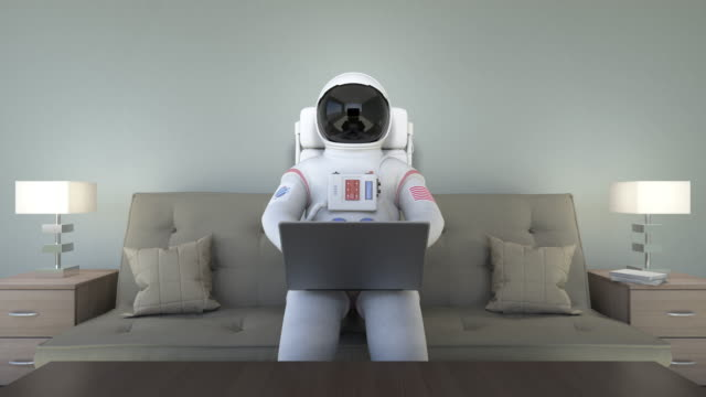 Astronaut Sitting On Couch And Working With Computer video