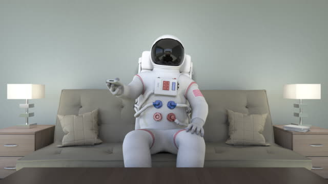 Astronaut Sitting On Couch Watching TV video