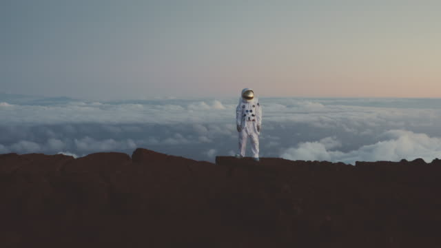 Astronaut standing at the top of the universe video