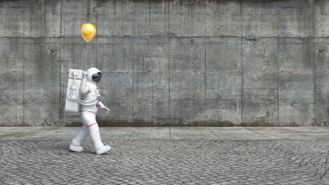 Astronaut Walking On A City Sidewalk Holding A Balloon video
