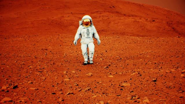 4 k astronaut walking på mars yta. (bakgrundselement inredda av nasa.) - mars bildbanksvideor och videomaterial från bakom kulisserna
