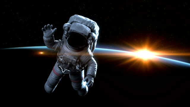 astronaut waves in outer space at dawn - układ słoneczny filmów i materiałów b-roll