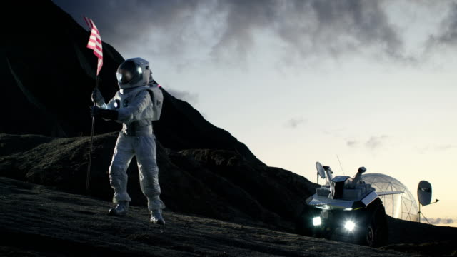 Astronaut Wearing Space Suit Plants American Flag on the Alien Planet. Patriotic and Proud Moment for the Whole of Humanity. Space Travel and Colonization Concept. video