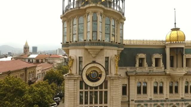 astronomical clock in batumi, building on corner of europe square, tourism - simbolo concettuale video stock e b–roll