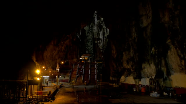 At Batu Caves, Malaysia seen interior of cave with stalactites and temple video