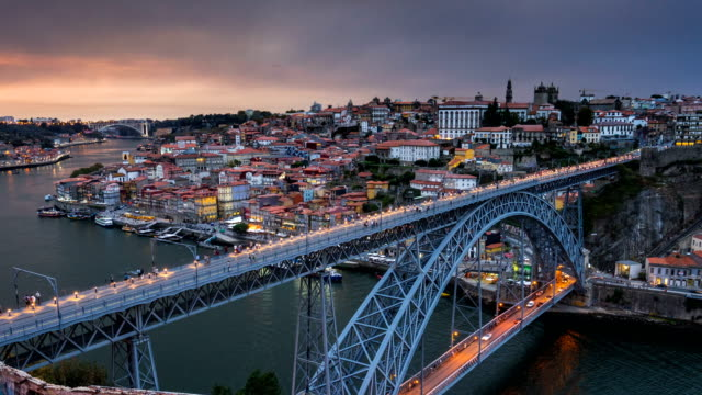 D2N T/L at Dom Luís I Bridge, Porto, Portugal Day to Night Time Lapse video at Dom Luís I Bridge (Ponte dom Luis I),  he Dom Luís I Bridge is a double-deck metal arch bridge that spans the River Douro between the cities of Porto and Vila Nova de Gaia in Portugal.Porto, Portugal. portugal stock videos & royalty-free footage