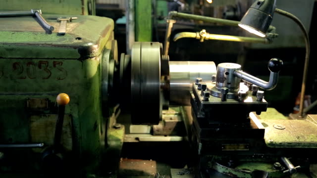 At the factory old horizontal lathe aligns layer of metal parts video