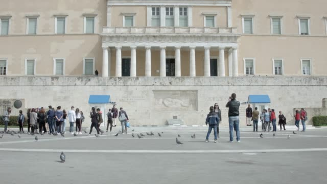 Athens - Timelapse - 4K RAW footage - tourists at Syntagma square, in front of the Greek Parliament and the presidential guard video