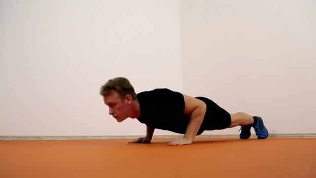 Athlete doing pushups Athlete doing pushups in the gym bodyweight training stock videos & royalty-free footage