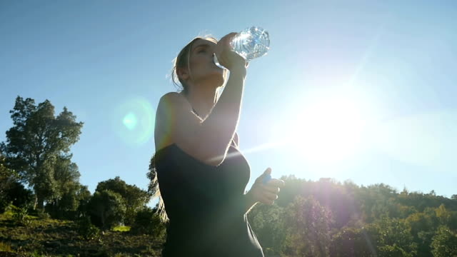 Athlete girl drinking water video