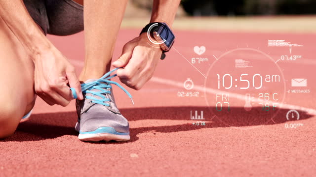 athlete in a smartwatch while tying shoe lace - sports medicine stock videos and b-roll footage