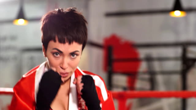 athlete making an assault. drive off an attack. organize the fight - kick boxing video stock e b–roll