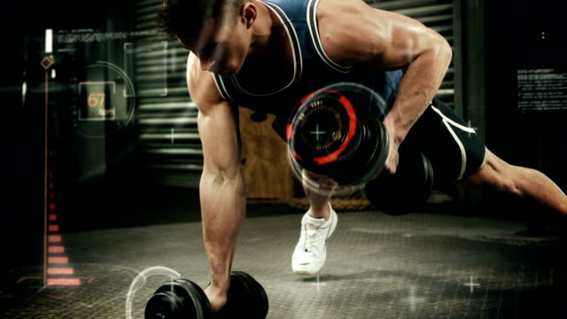 Athlete performing push ups with dumbbell against the animated background video
