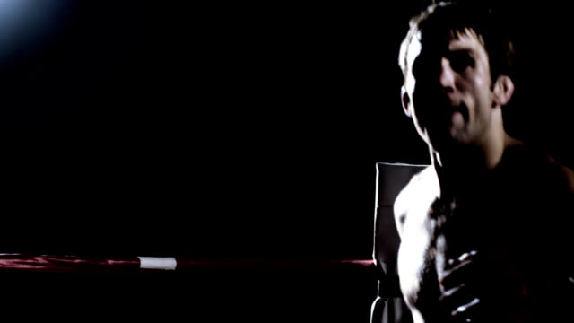 Athlete prepares himself for a mixed martial arts fight video