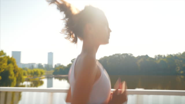 vídeos de stock e filmes b-roll de athlete woman exercising outdoor. - young woman running city