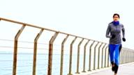 istock Athlete woman running on pier 636743154