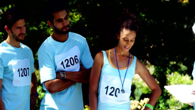 Athletes registering themselves for marathon 4k video