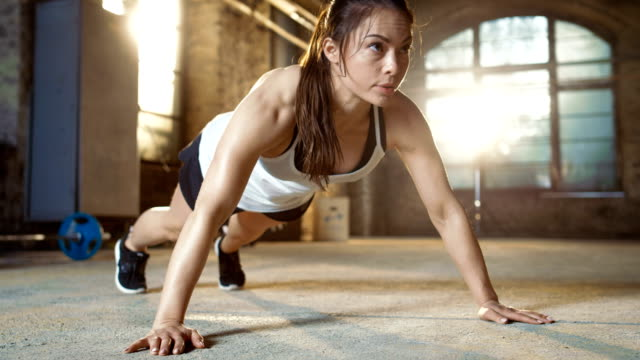 Athletic Beautiful Woman Does Push-ups as Part of Her Cross Fitness, Bodybuilding Gym Training Routine. Athletic Beautiful Woman Does Push-ups as Part of Her Cross Fitness, Bodybuilding Gym Training Routine. Shot on RED EPIC-W 8K Helium Cinema Camera. push ups stock videos & royalty-free footage