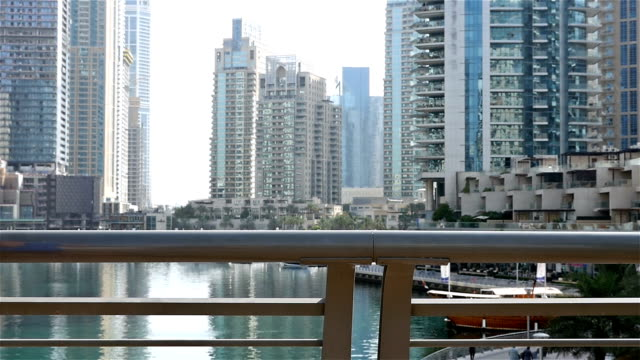 Athletic fitness man running jogging in Dubai Marina in the morning, slow motion video