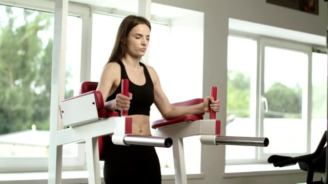 Athletic Girl Is At A Gym. Athletic girl is at a gym. Exercises with the gym equipment. bodyweight training stock videos & royalty-free footage