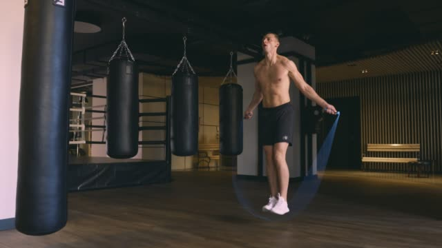Athletic man skipping with a jump rope video
