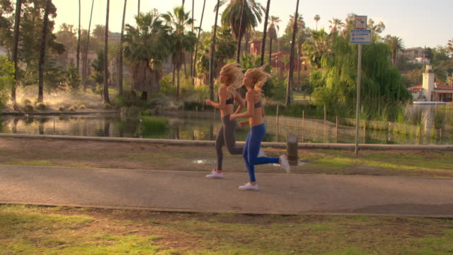 Athletic Twins Running Park Slow-Motion