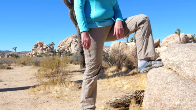 Athletic Woman In The Cowboy Hat Put His Foot On The Stone, Panorama Bottom-Up video