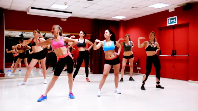athletic women dancing strip plastic video