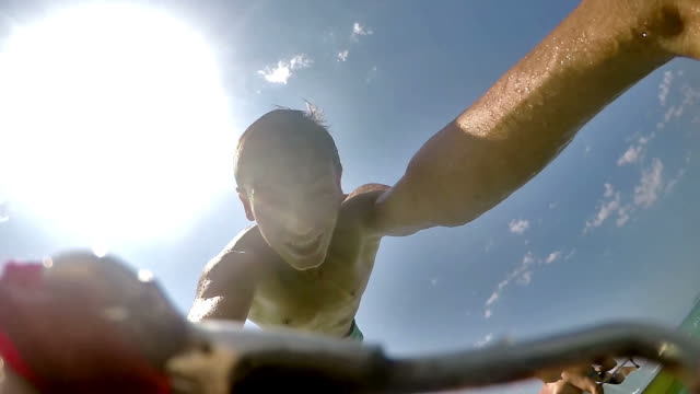 Athletic Young Man Jumping From Boat Into Ocean Sea Water SLOW MOTION video