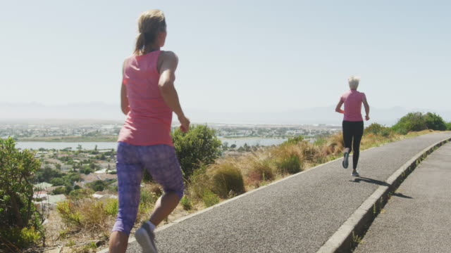 athletics women running on the road - active lifestyle stock videos & royalty-free footage